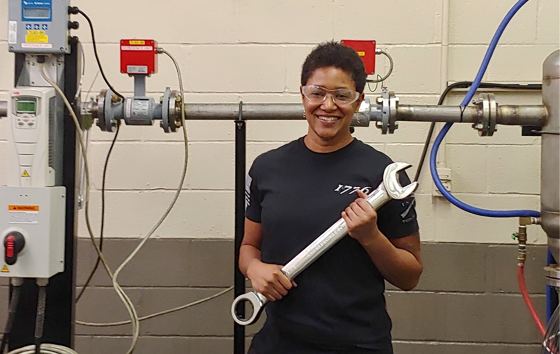 Electrical and electronics engineering technician Tracy Wilson with a wrench
