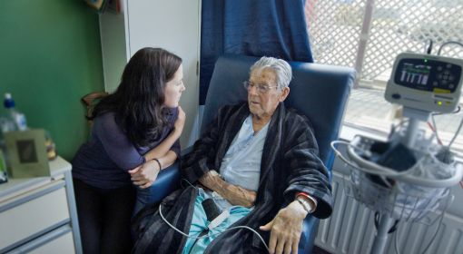 A social services assistant checks on an elderly client