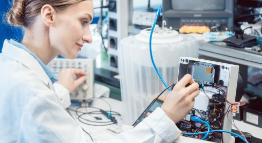 An electrical and electronics engineering technician tests a product in a lab for EMC compliance