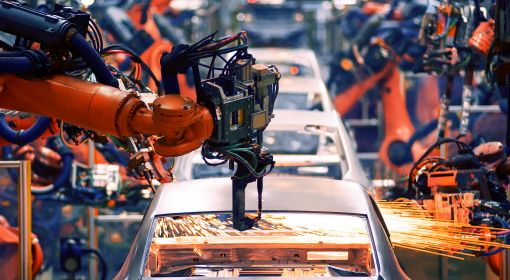 Electro-mechanical technicians maintain equipment like the robotic arm in a car factory