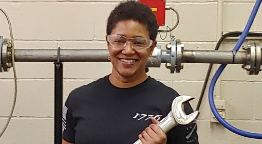 Electrical and electronics engineering technician Tracy Wilson with a large wrench