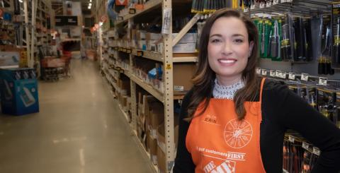 Erin Izen in Home Depot store with apron