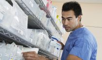 A pharmacy technician checks prescriptions